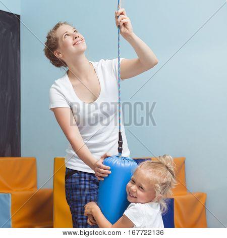 Child Exercising With Sensory Integration Equipment