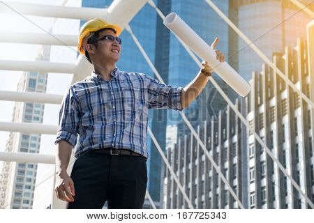 Foreman construction worker holding blueprint, occupation, workplace