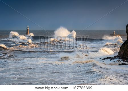 Choppy Waters at Tynemouth North Pier, as a stormy sea hits it, resulting in high crashing waves cascading into the mouth of the River Tyne