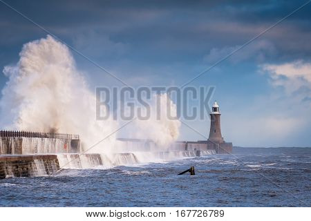 Storm Waves hit Tynemouth Pier, as a stormy sea hits it, resulting in high crashing waves cascading into the mouth of the River Tyne