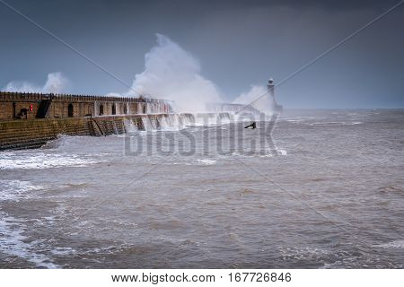 Tynemouth Storm Waves, as a stormy sea hits Tynemouth North Pier, resulting in high crashing waves cascading into the mouth of the River Tyne