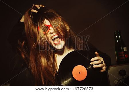 Portrait of the girl with vinyl dressed in sunglasses