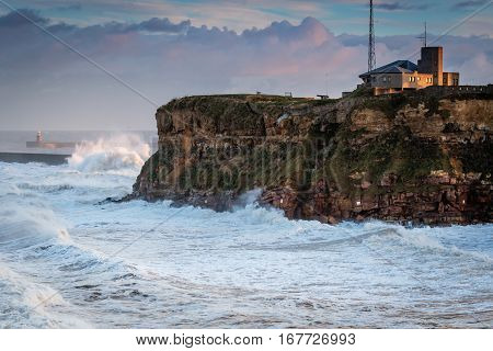 Tynemouth Coast Guard Station and Stormy Sea, as it hits Tynemouth North Pier resulting in high crashing waves cascading into the mouth of the River Tyne