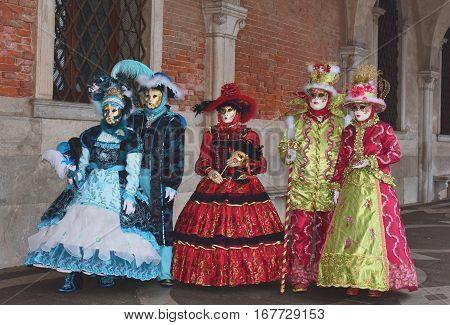 VENICE, ITALY - FEBRAURY 2: Carnival of Venice beautiful masks under Doge Palace portico FEBRUARY 2, 2016 in Venice, Italy