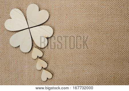 Wood hearts on hessian texture background valentine background