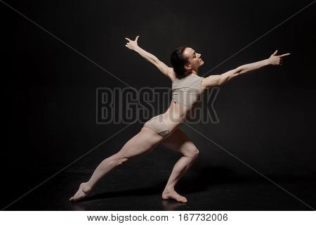 Concentrated during my rehearsal. Charismatic flexible young ballet dancer performing in the studio and expressing grace and elegance while demonstrating her skills