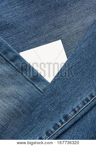 White tag between blue jeans cloth around close up