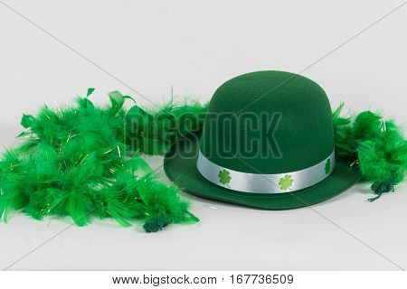 Green felt hat with feather boa for St. Patrick's Day background