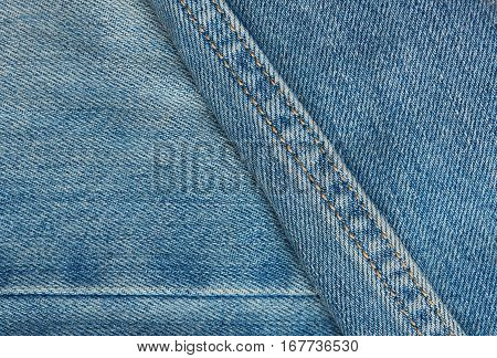 light blue jeans surface with stiches close up