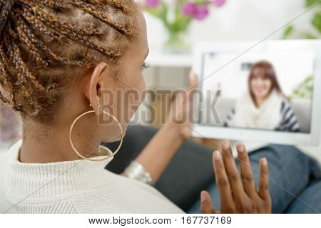 friends talking to each other via online video chat.
