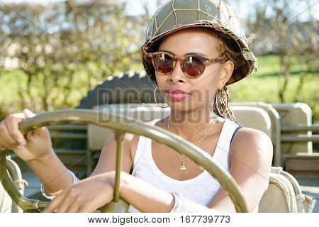 beautiful black young girl with ww2 military helmet