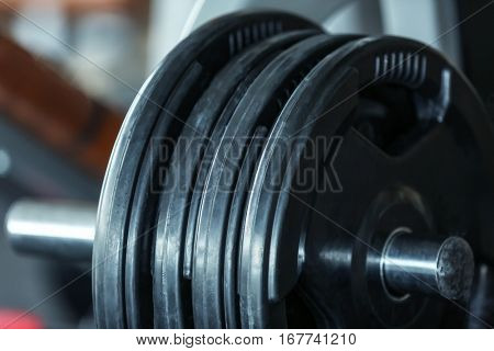Rack with weight plates in gym, close up view