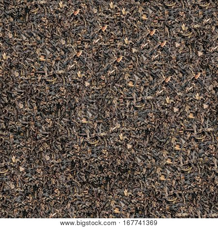 Pile of aromatic black dry tea leaves isolated