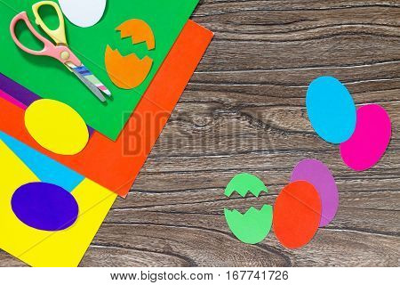 Easter Frame Craft. Easter Greeting Paper Easter Eggs On A Wooden Table. Copy Space. Children's Art