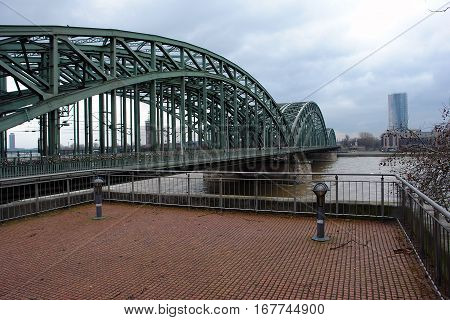 View on right bank of the Rhine in Cologne and Hohenzollern Bridge in cloudy weather Germany. Panorama of the city