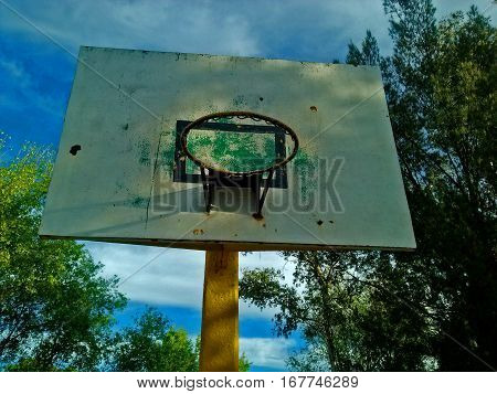 Front view of basketball hoop on a sunny morning