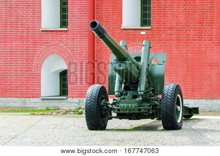 Artillery gun on a wheeled platform standing in the courtyard of the Peter and Paul fortress in Saint-Petersburg.
