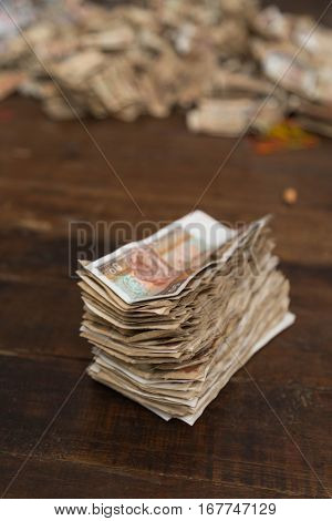 A pile of old, used Myanmar banknotes