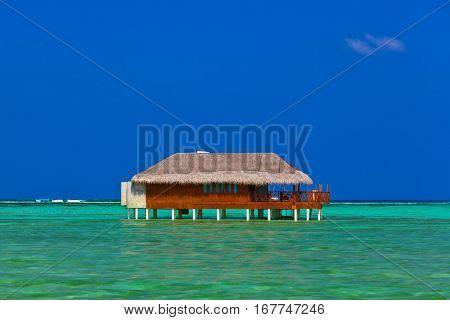 Water bungalow on Maldives island - nature travel background