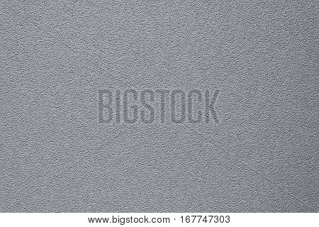 Abstract gray background of the spots of brown and white paint on the yellow plastered wall.