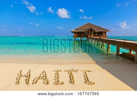 Word Haiti on beach - nature holiday background
