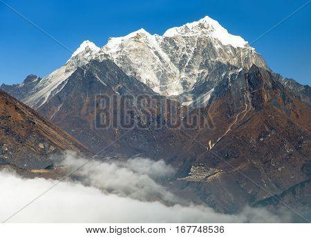 View of Portse village mount cholatse and Tabuche peak - way to Everest base camp - Sagarmatha national park - Nepal