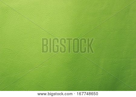 Lime green leather texture closeup background. Structured background design nubuk