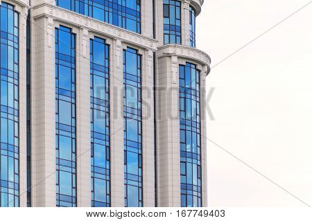 multi-storey glass skyscraper office building on a white background.