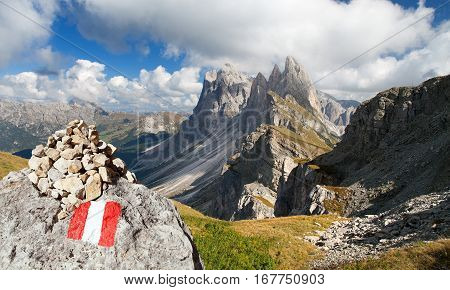 View of Geislergruppe or Gruppo delle Odle with tourist sign Italian Dolomites mountains