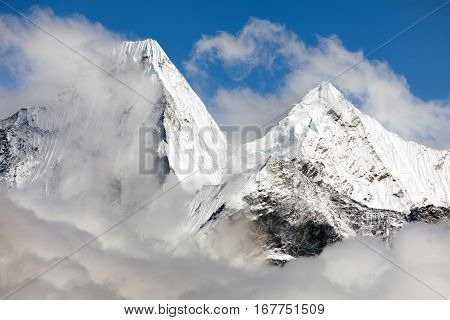 Malangphulang Beautiful panoramic view of himalayas with clouds near mount Ama Dablam on the way to Everest base camp Nepal