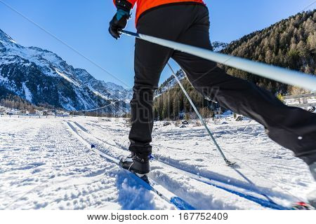 Cross-country skiing on the trail in cold sunny winter day in Solda/Sulden, Val Venosta, Italy.