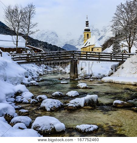 View of scenic winter landscape in the Bavarian Alps with famous Parish Church of St. Sebastian in the village of Ramsau, Nationalpark Berchtesgadener Land in Upper Bavaria, Germany.