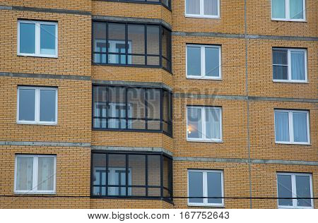 new multi-storey houses built of brick and multiple windows