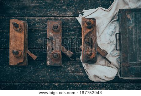 Old and rusty tools on a old board background. Flat lay and top view