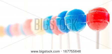 Close up view of a row of lollipops