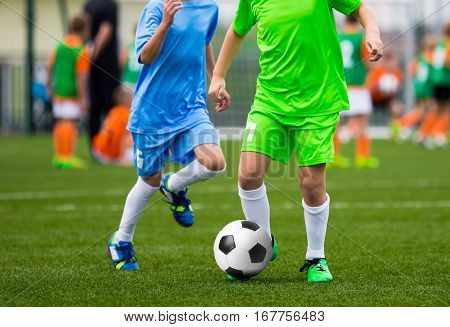 Youth Soccer Players. Boys Kicking Football Ball on the Field. Football Tournament for Kids