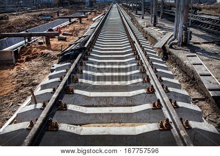 Concrete railroad ties in railway construction site. Perspective view