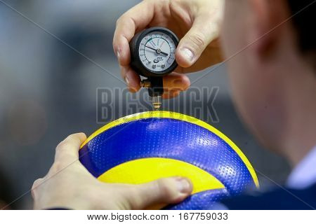 The Referee Counts The Air Pressure On The Ball Before The Game Of Volleyball