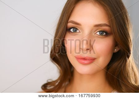 Beautiful female in sundress posing on white background.