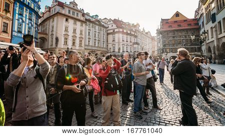 Prague, Czech Republic - October 13, 2014: Group of tourists taking photo of town hall with astronomical clock - Orloj