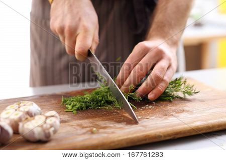Cook the sliced fennel. Cautious chopping vegetables. Hands chef chopping vegetables on worktop