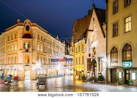 Tallinn, Estonia - December 2, 2016: Vanaturu Street In Historical Centre Of Old Town In Evening Illumination. Traditional Medieval Houses On Old Narrow Street. Tallinn, Estonia