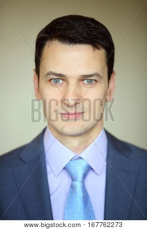 Smiling elegance brunet man in business suit with tie in studio