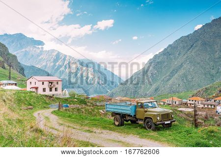 Georgia. GAZ-53 - Old Soviet Russian medium-duty truck parking near village Tsdo in summer mountains landscape in Darial Gorge, Georgia.