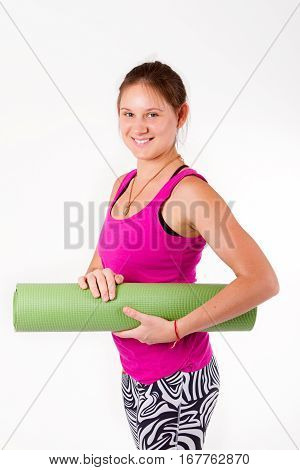 Sports girl with mat for sports in the hands on a white background