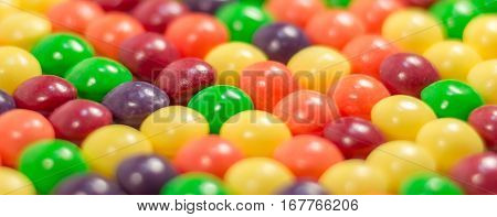 Multi colored pills or bubbles background vitamins close up