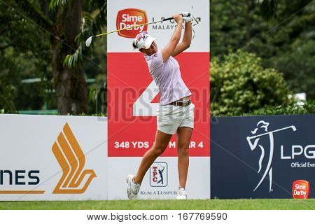 KUALA LUMPUR, MALAYSIA - OCTOBER 29, 2016: Lee-Anne Pace of South Africa tees off from the T-box of the 4th hole at the TPC Golf Course at the 2016 Sime Darby LPGA Malaysia golf tournament.