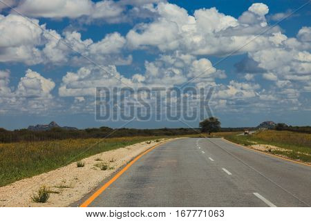 South African Road Through The Savannas And Deserts With Markings And Traffic Signs. .