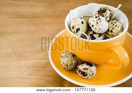 Table Setting for Easter Celebration With Quail Eggs and Easter Bunny on Rustic Wooden Table. Spring Time. Holidays background. Selective Focus. Copy Space.
