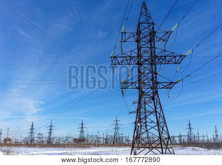 high voltage power lines at blue sky. electricity distribution station. high voltage electric transmission tower.